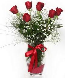 7 adet gülden cam içerisinde güller  Konya çiçek siparişi sitesi